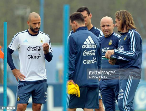 Argentina's football team coach Jorge Sampaoli talks with forward Lionel Messi and defender Javier Mascherano during a training session in Ezeiza...