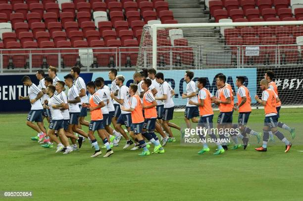 Argentina's football team take part in a training session at the National Stadium in Singapore on June 12 2017 Argentina will play Singapore in an...