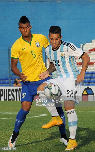 Argentina's footballer Sebastian Driussi vies for the ball with Brazil's Wallace during their South American U 20 football match at the Parque...