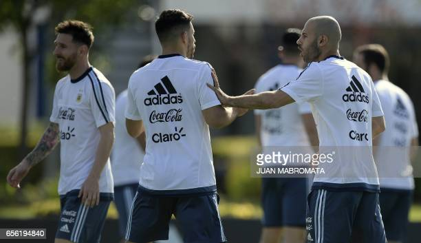 Argentina's footballers Javier Mascherano Sergio Aguero and Lionel Messi take part in a training session in Ezeiza Buenos Aires on March 21 2017...
