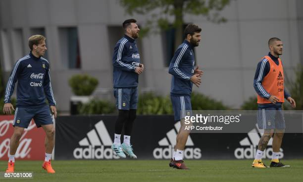 Argentina's footballers Lucas Biglia Lionel Messi Federico Fazio and Mauro Icardi take part in a training session in Ezeiza Buenos Aires on October 3...