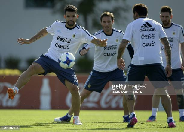 Argentina's footballers Sergio Aguero Lucas Biglia Ezequiel Lavezzi and Lionel Messi take part in a training session in Ezeiza Buenos Aires on March...