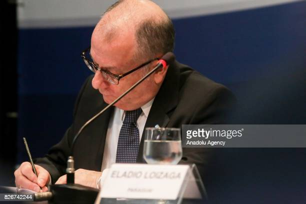 Argentina's Foreign Minister Jorge Faurie takes notes during a meeting on South American trade bloc Mercosur to suspend Venezuela for failing to...