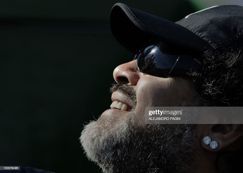 Argentina's former football crack Diego Maradona gestures during the 2012 Davis Cup semifinals singles tennis match between Argentina and Czech Republic, at Parque Roca stadium in Buenos Aires, on September 16, 2012.