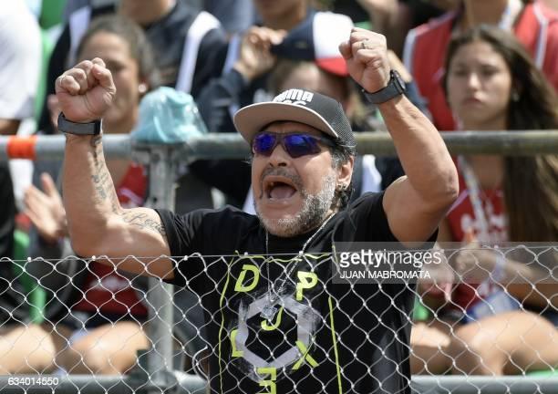 Argentina's former footballer Diego Maradona cheers during the 2017 Davis Cup World Group first round single tennis match between Argentina's tennis...