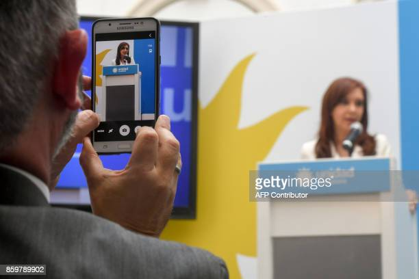 Argentina's former president and Buenos Aires senatorial candidate for the Unidad Ciudadana Party Cristina Fernandez de Kirchner gestures during a...