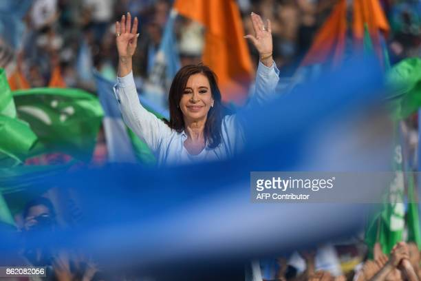Argentina's former President and Buenos Aires senatorial candidate for the Unidad Ciudadana Party Cristina Fernandez de Kirchner waves to supporters...