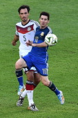 Argentina's forward and captain Lionel Messi competes for the ball with Germany's defender Mats Hummels during the final football match between...