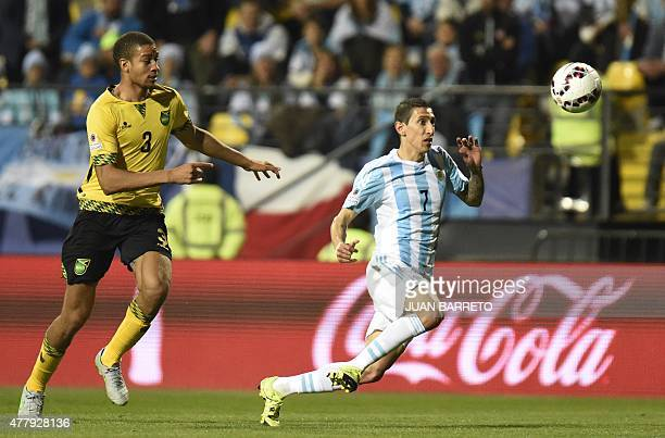 Argentina's forward Angel Di Maria and Jamaica's defender Michael Hector vie for the ball during the 2015 Copa America football championship match in...