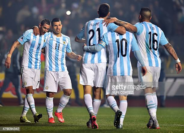 Argentina's forward Angel Di Maria celebrates with teammates after scoring against Paraguay during their Copa America semifinal football match in...
