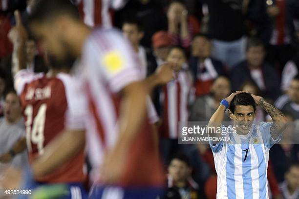 Argentina's forward Angel Di Maria gestures during their Russia 2018 FIFA World Cup South American Qualifiers football match against Paraguay at the...