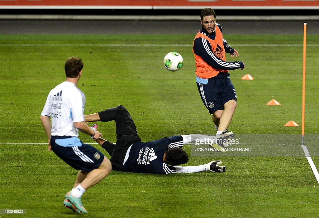 Argentina's forward Gonzalo Higuain (R) and goalkeeper Sergio Romero take part in a training session of the Argentina national football team at the 'Friends Arena' in Stockholm, Sweden, on February 4, 2013 two days before the FIFA World Cup 2014 friendly match Sweden vs Argentina.