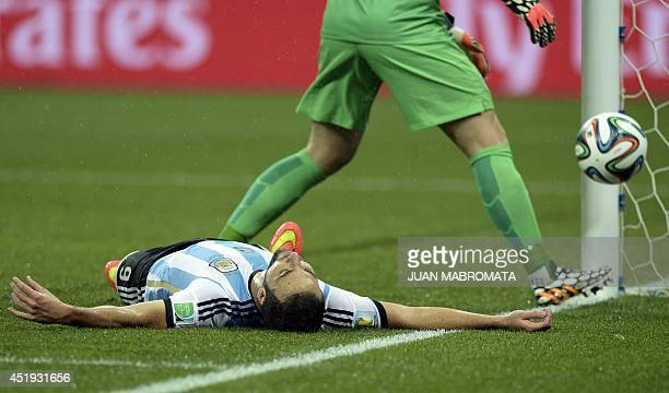 Argentina's forward Gonzalo Higuain reacts after missing a shot on goal during the semifinal football match between Netherlands and Argentina of the...