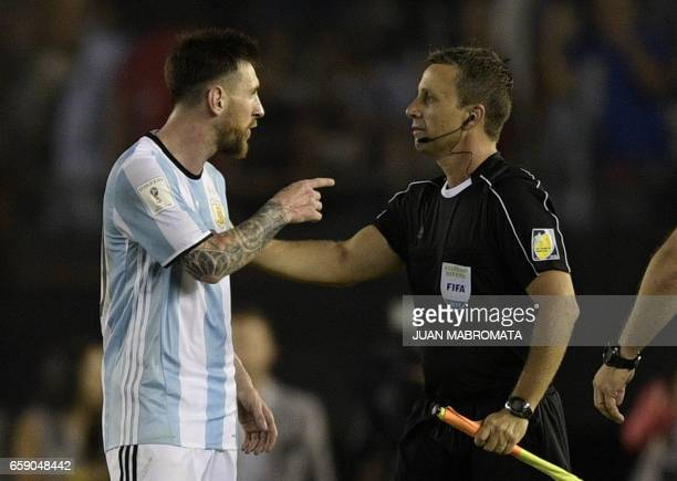 Argentina's forward Lionel Messi argues with first assistant referee Emerson Augusto de Carvalho at the end of their 2018 FIFA World Cup Russia South...