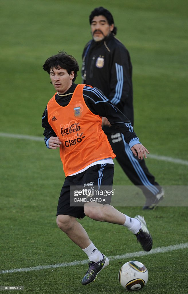 Argentina's forward Lionel Messi controls the ball in front of coach Diego Maradona during a team training session at the University's High Performance Centre in Pretoria on June 6, 2010 ahead of the start of the 2010 World Cup football tournament.