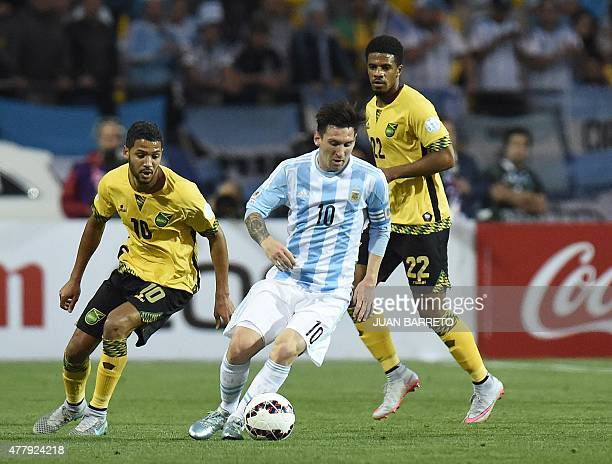 Argentina's forward Lionel Messi dribbles past Jamaica's midfielders Joel McAnuff and Jamaica's midfielder Garath McCleary during their 2015 Copa...
