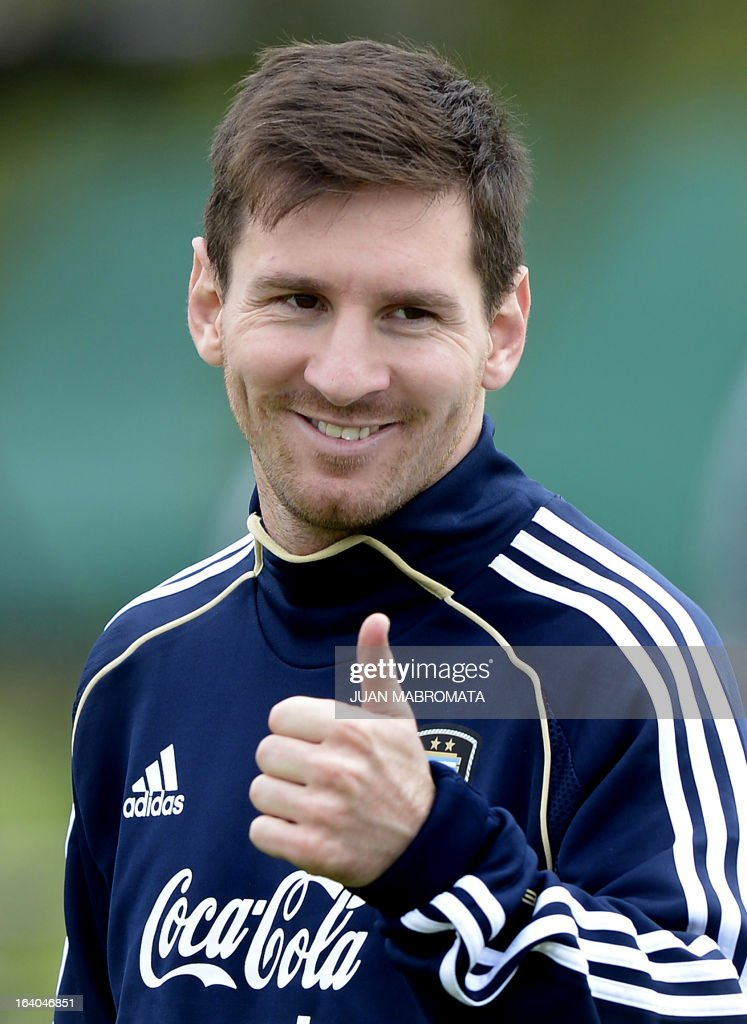 Argentina's forward Lionel Messi gives the thumb up during a training session in Ezeiza, Buenos Aires on March 19, 2013 ahead of the Brazil 2014 FIFA World Cup South American qualifier football match against Venezuela on March 22. AFP PHOTO / Juan Mabromata