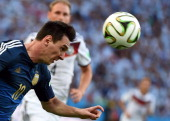 Argentina's forward Lionel Messi heads the ball during the final football match between Germany and Argentina for the FIFA World Cup at The Maracana...