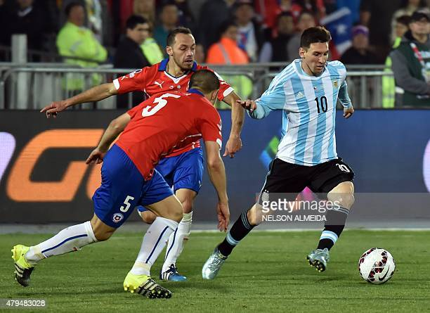Argentina's forward Lionel Messi is marked by Chile's midfielders Francisco Silva and Marcelo Diaz during their 2015 Copa America football...