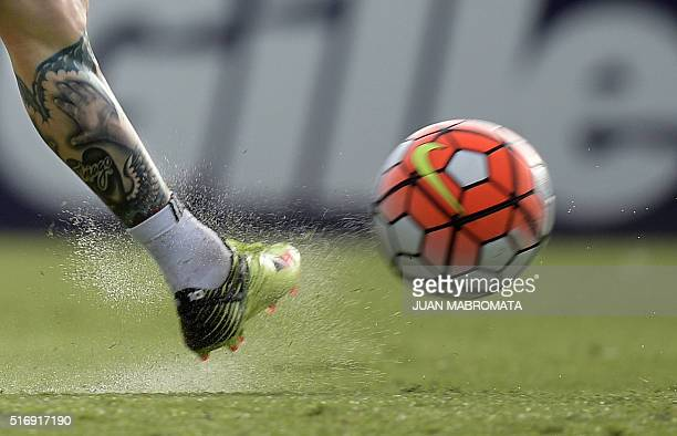 Argentina's forward Lionel Messi kicks the ball during a training session in Ezeiza Buenos Aires on March 21 2016 ahead of a 2018 FIFA World Cup...