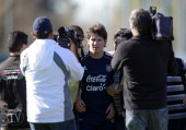 Argentina's forward Lionel Messi leaves the training session surrounded by journalists in Ezeiza Buenos Aires on May 29 2012 ahead a Brazil 2014 FIFA...