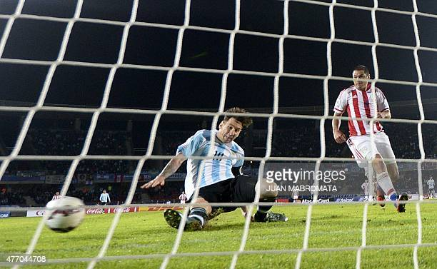 Argentina's forward Lionel Messi misses a goal opportunity against Paraguay during their 2015 Copa America football championship match in La Serena...