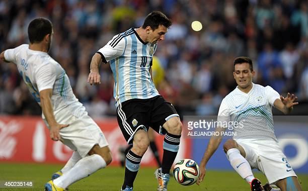 Argentina's forward Lionel Messi scores the team's second goal against Slovenia during a friendly football match at La Plata stadium in La Plata...
