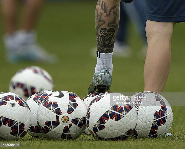 Argentina's forward Lionel Messi steps on a football during a training session in La Serena Coquimbo Chile on June 22 2015 ahead of ther Copa America...