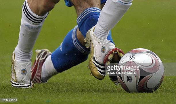 Argentina's forward Lionel Messi vies for the ball with Paraguay's midfielder Edgar Barreto during their FIFA World Cup South Africa 2010 qualifier...