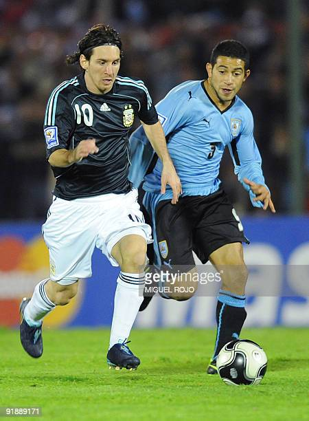 Argentina's forward Lionel Messi vies for the ball with Uruguay´s forward Luis Suarez during their FIFA World Cup South Africa 2010 qualifier...