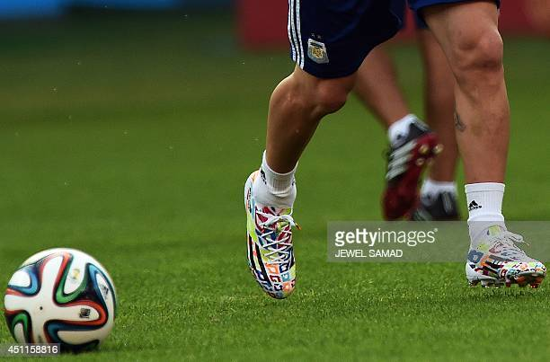 Argentina's forward Lionel Messi wears a special edition boot made to celebrate his 27th birthday during a training session at the BeiraRio Stadium...