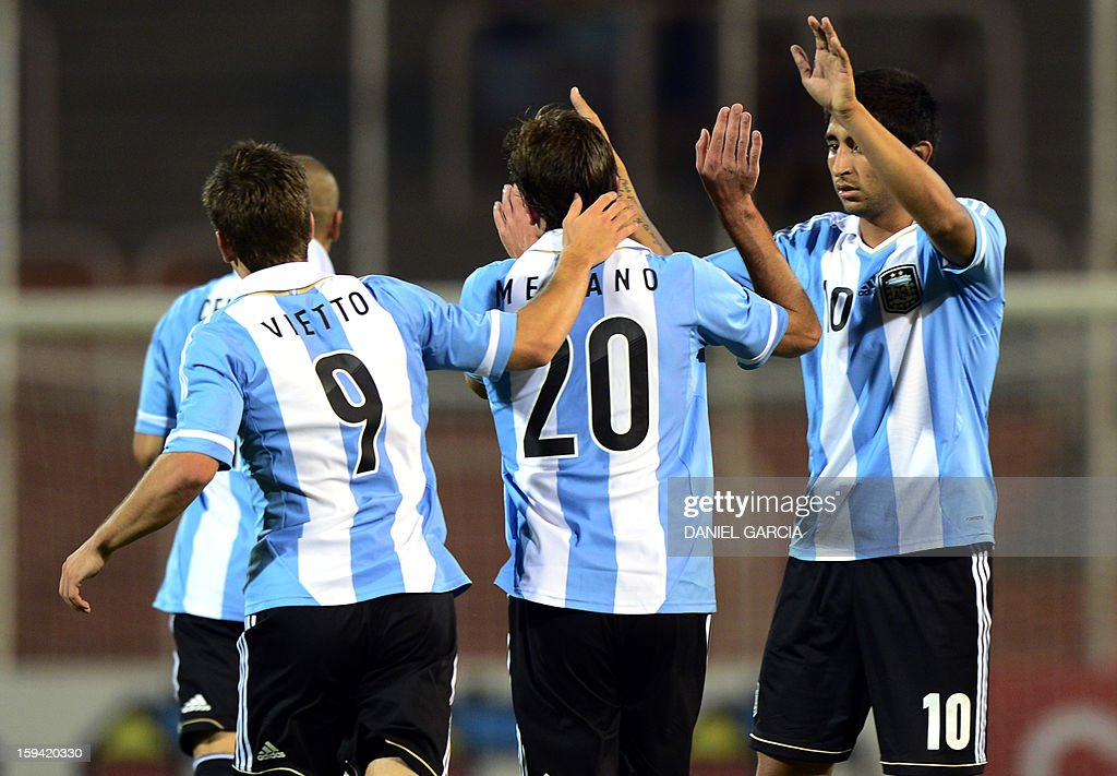 Argentina's forward Lucas Melano (C) celebrates with teammates after scoring against Bolivia during their Group A South American U-20 qualifier football match at Malvinas Argentinas stadium in Mendoza, Argentina, on January 13, 2013. Four teams will qualify for the FIFA U-20 World Cup Turkey 2013. AFP PHOTO / DANIEL GARCIA