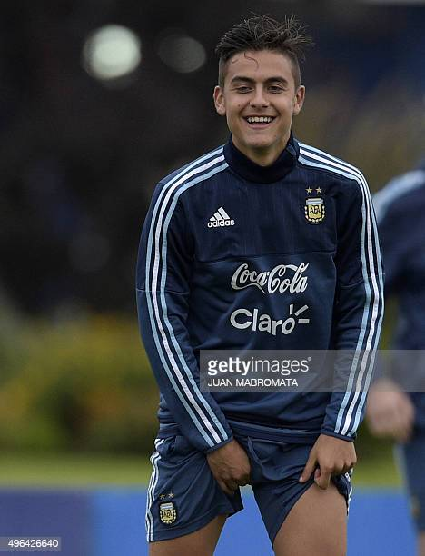 Argentina's forward Paulo Dybala gestures during a training session in Ezeiza Buenos Aires on November 9 2015 Argentina will face Brazil in FIFA...