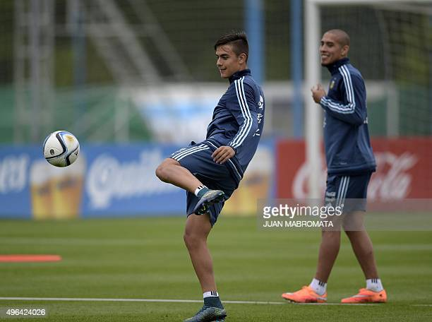 Argentina's forward Paulo Dybala strikes the ball during a training session in Ezeiza Buenos Aires on November 9 2015 Argentina will face Brazil in...