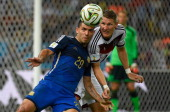 Argentina's forward Sergio Aguero vies with Germany's midfielder Bastian Schweinsteiger during the final football match between Germany and Argentina...