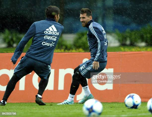Argentina's forwards Lionel Messi and Paulo Dybala take part in a training session in Ezeiza Buenos Aires on September 3 2017 ahead of a 2018 FIFA...