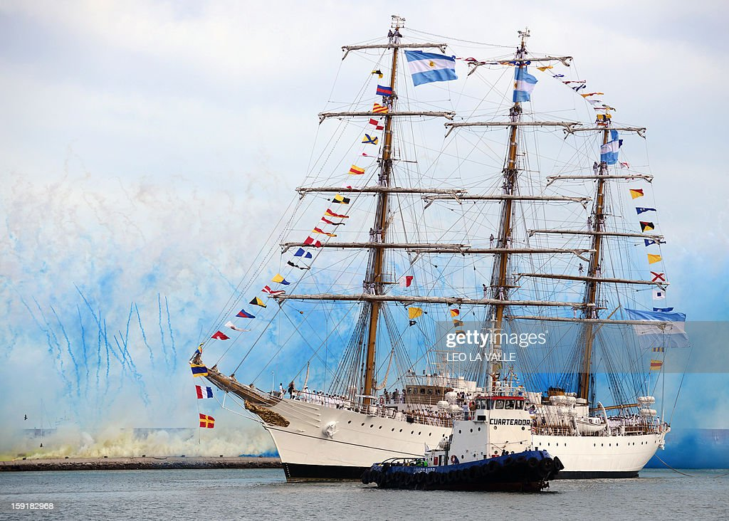 Argentina's frigate Libertad sails amidst fireworks exploding upon arrival in Mar del Plata, 400km south of Buenos Aires, Argentina on January 9, 2013. The Libertad had been detained for two months in Ghana due to a debt the Argentine government holds with a financial fund since they defaulted during an economic crisis in 2001. AFP PHOTO/Leo LA