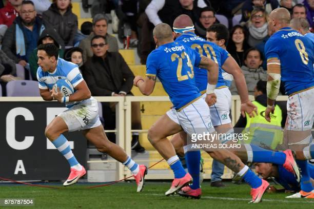 Argentina's full back Joaquin Tuculet runs with the ball to score a try during the International Rugby Union Test match between Italy and Argentina...
