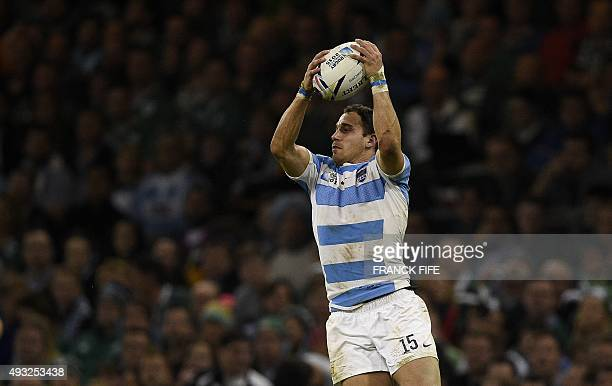 Argentina's fullback Joaquin Tuculet grabs the ball during a quarter final match of the 2015 Rugby World Cup between Ireland and Argentina at the...