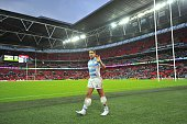 Argentina's fullback Joaquin Tuculet waves ass he leaves the pitch with ice bags strapped to his shins after a Pool C match of the 2015 Rugby World...