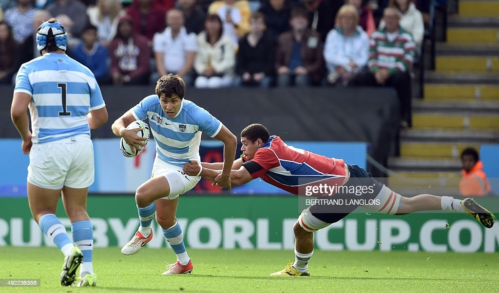 Argentina's fullback Lucas Amorosino is tackled during a Pool C match of the 2015 Rugby World Cup between Argentina and Namibia at Leicester City...