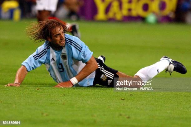 Argentina's Gabriel Batistuta lies on the ground after missing a chance against England
