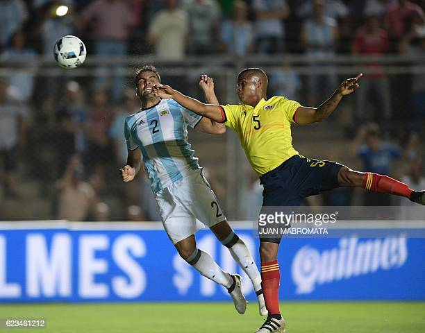 Argentina's Gabriel Mercado and Colombia's midfielder Wilmar Barrios vie for the ball during their 2018 FIFA World Cup qualifier football match in...