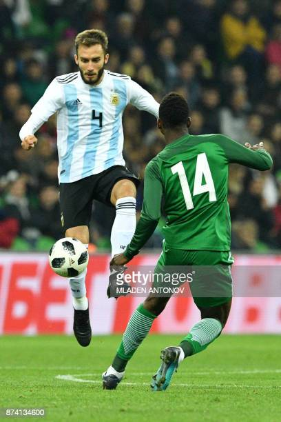 Argentina's German Pezzella and Nigeria's Kelechi Iheanacho vie for the ball during an international friendly football match between Argentina and...