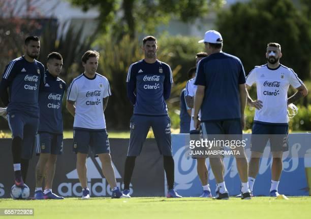 Argentina's goalkeeper Sergio Romero players Angel Correa Lucas Biglia goalkeeper Mariano Andujar Ezequiel Lavezzi and forward Lucas Pratto listen to...