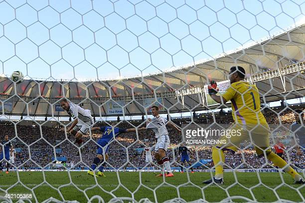 Argentina's goalkeeper Sergio Romero prepares to save a header on goal by Germany's defender Benedikt Hoewedes during the first half of the 2014 FIFA...