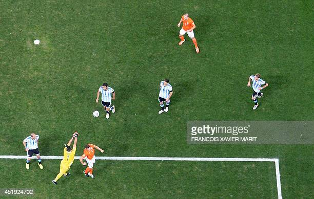 Argentina's goalkeeper Sergio Romero punches an aerial ball during the semifinal football match between Netherlands and Argentina of the FIFA World...