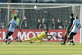 Argentina's goalkeeper Sergio Romero saves a shot during their 2015 Copa America football championship final against Chile in Santiago Chile on July...