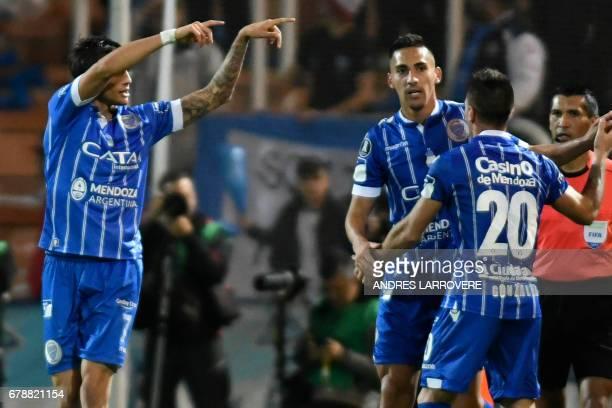 Argentina's Godoy Cruz player Juan Fernando Garro celebrates with teammates after scoring a goal against Paraguay's Libertad during their Copa...