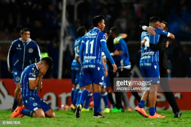 Argentina's Godoy Cruz players celebrate qualifying for the next round in their Copa Libertadores 2017 football match against Paraguay's Libertad at...